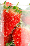 Strawberries in the water Royalty Free Stock Photography