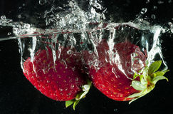 Strawberries in water Royalty Free Stock Image