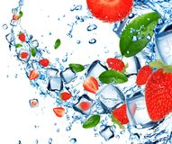 Strawberries in water splash Stock Photos