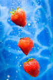 Strawberries in a water splash. Strawberries dropping ina splash of water drops stock photography
