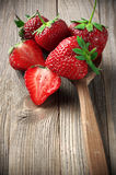 Strawberries on weathered wood Stock Photos