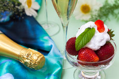 Strawberries with whipped cream Stock Images