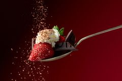 Strawberries with whipped cream and chocolate pieces sprinkle with chocolate chips stock image