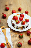 Strawberries and whipped cream  for dessert. Pancakes with  stra Stock Image