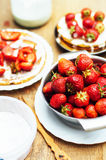 Strawberries and whipped cream  for dessert. Pancakes with  stra Royalty Free Stock Photo