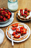 Strawberries and whipped cream  for dessert. Pancakes with  stra Royalty Free Stock Photography