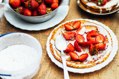Strawberries and whipped cream for dessert. Pancakes with stra Royalty Free Stock Image