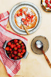 Strawberries and whipped cream for dessert. Pancakes with stra Stock Images