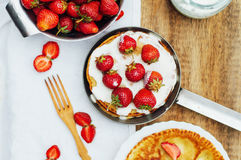 Strawberries and whipped cream for dessert. Pancakes with stra Stock Photo