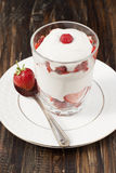Strawberries with whipped cream . Royalty Free Stock Images