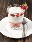 Strawberries with whipped cream  . Stock Images