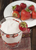 Strawberries with whipped cream Stock Photography