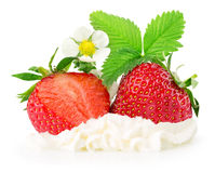 Strawberries with whipped cream isolated on the white background Royalty Free Stock Image