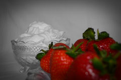 Strawberries and whipped cream Stock Photos