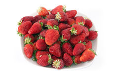 Strawberries on white. Background in a bowl Stock Images
