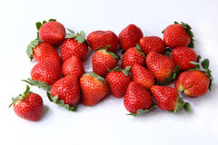 Strawberries on the white background Stock Photos