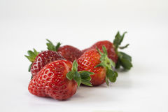 Strawberries on white background. Five Strawberries  on a white background Royalty Free Stock Image