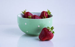 Strawberries.  on a white background. Strawberries in a green bowl in white peas Stock Images