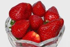 Strawberries on white. Stock Photos