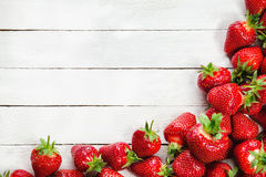 Strawberries On White Board Stock Images