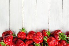 Strawberries On White Board Royalty Free Stock Photos