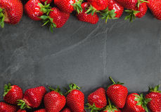 Strawberries On White Board Stock Photos