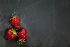 Strawberries On White Board stock image