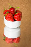 Strawberries in white bowl Royalty Free Stock Photos