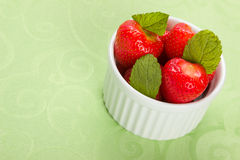 Strawberries in white bowl Stock Photography