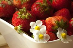 Strawberries in a white bowl. Healthy breakfast with fresh strawberries Royalty Free Stock Photography