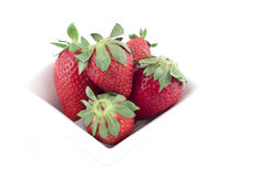 Strawberries. In a white bowl on a white background Royalty Free Stock Photos
