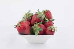 Strawberries. In a white bowl on a white background Stock Image