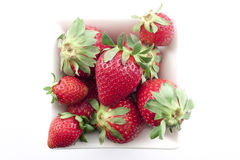 Strawberries. In a white bowl on a white background Royalty Free Stock Image
