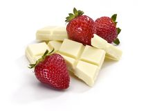 Strawberries and white chocolate pieces royalty free stock image
