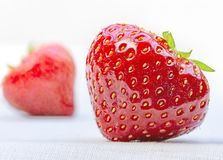 Strawberries on white cotton tablecloth Stock Photography