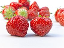 Strawberries on white cotton tablecloth Royalty Free Stock Image