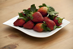 Strawberries on white dish. Tasty strawberries on white dish Royalty Free Stock Image