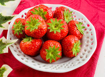 Strawberries on white dish Royalty Free Stock Image