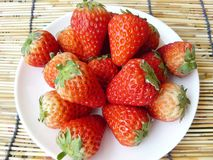 Strawberries on white plate Stock Photo