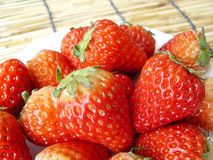 Strawberries on white plate Royalty Free Stock Photography