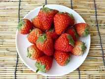 Strawberries on white plate Stock Image