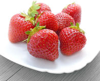 Strawberries on a white plate Royalty Free Stock Image