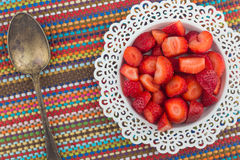 Strawberries on a white plate Stock Photos