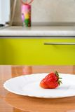 Strawberries on a white plate Royalty Free Stock Photo