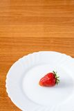 Strawberries on a white plate Royalty Free Stock Photos