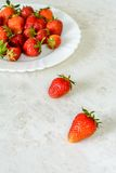 Strawberries on a white plate Stock Images