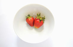 Strawberries in white plate Royalty Free Stock Photography