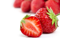 Strawberries on white stock images