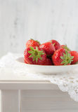 Strawberries on a white table Royalty Free Stock Image