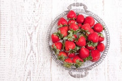 Strawberries on white wood Royalty Free Stock Image